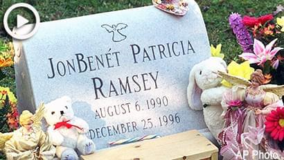 The grave-site of JonBenet Ramsey had a few visitors in Marietta, Ga. on Dec. 26, 1997. A new headstone was reportedly installed the past Friday. (Joe McTyre/Atlanta Journal-Constitution via AP)
